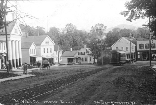 Lower Main Street with trolley and pedestrians, c1915.