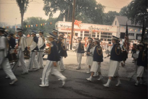 Marching band by gas station 1960s, Bank and Main streets.