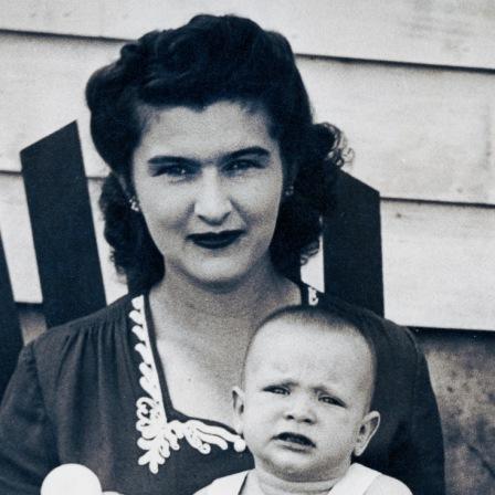 Marguerite Mackey holding baby.