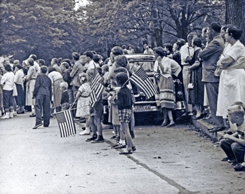 Spectators along parade route c1950.