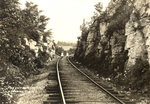Two girls walking through rail cut near Paran Creek c1915