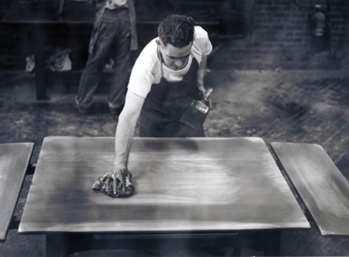 Charles Brean finishing a table